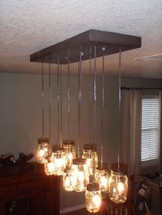 Mason jar chandelier inspired by Pottery Barn.  Switch out the ceiling mount for a weathered wooden plank?  I want this over my dining table!