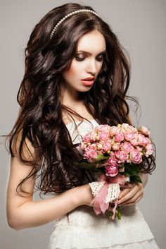 Unique wedding hair style for long hair with curls and big waves. This look is specially beautiful with a narrow head band to match your wedding gown. http://www.hairperfecter.com/wedding-hair-tips/