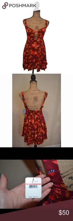 Free People Latrice Lovers Dress NWT, never worn! Beautiful red combo print with a lattice neckline. Size: xs. Floral printed swingy slip features lattice detailing on the bust and a ruffle hem. Smocked elastic band in back for an east fit and pleating. Free People Dresses Mini