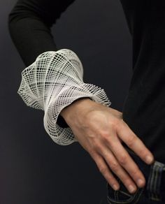 Guilloché Cuffs by Gregory Phillips uses a virtual guilloché engine and 3D printing to create a modern, three-dimensional take on a centuries old machine method for engraving intricate, repetitive 2D patterns.