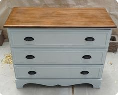 I wouldn't do the black pulls, the gray would be a little more antiqued with some ecru, and the top would be more cherry, but this would be awesome for Celia's dresser. This way I can mix and match her current cherry wood furniture with the painted furniture I want to do.