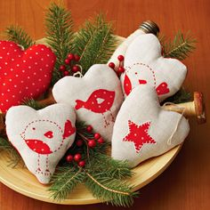 Spread your love this holiday season with heart shapes that brighten a bowl, your tree, and gift packages. Iron-on fabric scraps and a few embroidery stitches make the ornaments easy to craft in multiples.