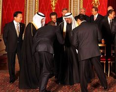 "The Bow Heard Around The World:  A deep bow from the waist is a recognized sign of submission to the person you are bowing to, in much the same way that a dog will lay down before it's master. The meaning of the word ""Islam"" is 'submission'. That is what you are watching in this photo - Obama, as the leader of America, submitting to a foreign, Muslim king. You will note that the King is not bowing in return, but instead maintains the superior position."