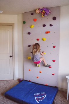Rock wall for kids play room- how fun!  What a great way to keep the kids…
