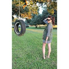 Utility vest, striped dress, tire swing