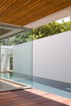 Indoor-outdoor pool inside the K House by Alroy Hazak architects _