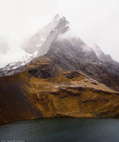 A sharp peak rising out of a lagoon at the foot of a mountain was one of the stunning phot...