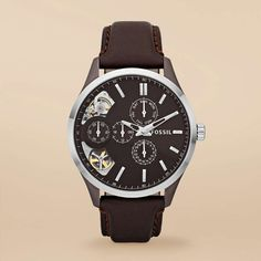 Dress Leather Watch – Brown $155    We love the classic and sleek look of this stainless steel and rich leather timepiece. A window in the dial reveals the inner workings of this must-have watch.