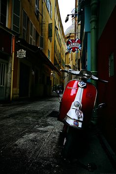 Vespa in front of a Tattoo Shop.