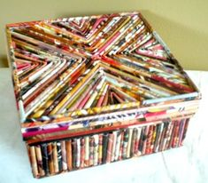 This box was inspired by the one I saw and so I covered a cardboard (tag board?) box and lid with magazine page reeds. I have many reeds in many different colors so it's fun to use them for...