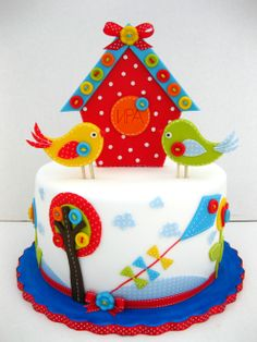 "Birdhouse cake. I like the vivid colors, fairly masculine for the bird theme. We can use this as the base for the decor since most ""bird"" theme stuff is girly pastel."