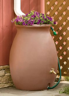 """Features: -Can be used with a water pump. Product Type: -Rain Barrel. Capacity: -50 Gallons. Material: -Plastic. Dimensions: Overall Height - Top to Bottom: -33"""". Overall Width - Side to Side: -"""