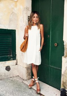 5 Summer Outfits to Wear to Work - Ease into the week's end with a breezy white dress and a summery pair of espadrilles.