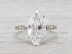 Vintage Art Deco Oval Cut Diamond Engagement Ring - I wish more of these vintage rings were done in yellow gold. :(