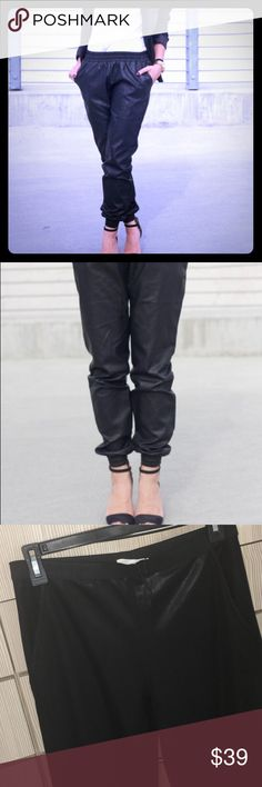 Zara leather looking sweatpants, NWT , leather looking like fancy FABRIC , (not vinyl or plastic ) super stylish , leather finish thick resilient fabric , elastic band on waist and ankles, sides pockets , loose fit , stretch at waist and ankles cause the elastics bands , the fabric doesn't stretch Zara Pants Ankle & Cropped
