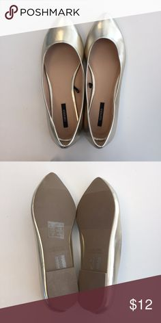 NWOT Gold flats Has just been in storage and never worn. In a gold/metalicy color. Forever 21 Shoes Flats & Loafers