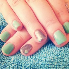 Gel polish Mint nails with hearts and silver glitter nail.