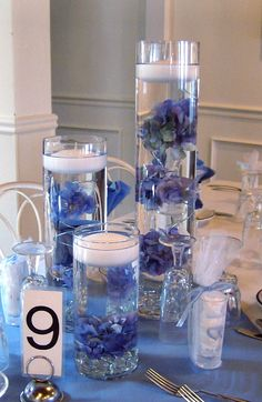 Trio Vase Centerpiece with Blue Hydrangea Tufts and Floating Candles
