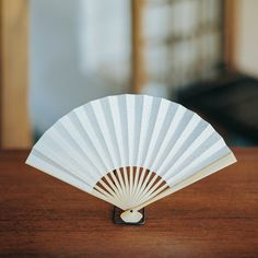 A delicate handmade paper fan