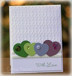 handmade Valentine card ... non-traditional colors ... simple layout ... row of punched out hearts ... like that each heart has a different type of embellishment ...