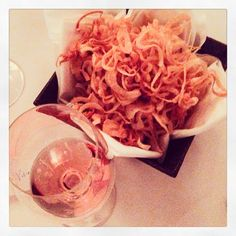 Rosé and a gigantic basket of friend onions. Need a new word for YES.