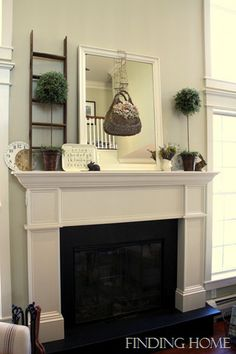 I like the black accent around the box.  Too simple of a mantel for my taste though.  Jeff, I like black granite.  No sparklies in it though.