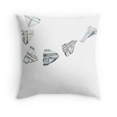 """paper airplane"" Throw Pillows by mzbrozek 