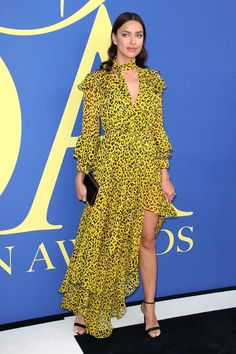 a72a55a700b9 Irina Shayk flashed her cleavage in a a Yellow Leopard-print Dress on the  2018 CFDA Fashion Awards red carpet at the Brooklyn Museum in New York City  on ...