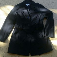 "Womans Black Peacoat Merona Womans Black Button Up Jacket/ Coat. Peacoat style. 3 buttons. Side pockets. Size Medium. Outer shell: 100% Polyester. Lining: 100% Polyester. Has a belt around the waist.  When buttoned, laying flat, from shoulder to bottom is 31"" long, across chest, 19"" wide. Sleeve length: 23"" long. No rips, tears or defects. Comes from a smoke free home. Merona Jackets & Coats Pea Coats"
