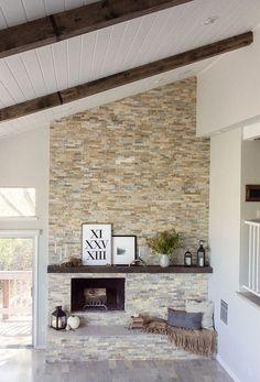 I love this idea over the brick. 3D Stone Tile fireplace!! https://www.pebbletileshop.com/products/3d-Polished-Grey-Brick-Stone-Tile.html#.VOuqhPnF-1U: