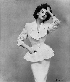 "Model Dorian Leigh (1917-2008). Dorian was one of the first models to be known by name, and the first ""supermodel"". After her own modeling career, she opened what is called the first modeling agency in Paris.      Suit by Lilli Ann, photo by Richard Avedon for Harper's Bazaar, June 1953"