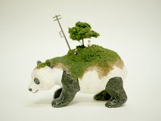"""Maico Akiba, whose series, """"100 years later,"""" we previously featured, has another project simply titled SEKAI, or """"world."""" In it, she imagines miniature ecosystems growing on the backs of other animals."""