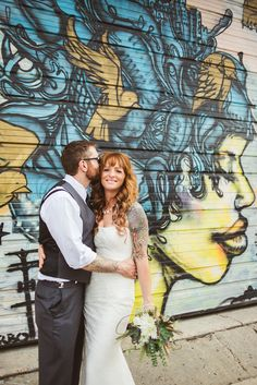 Tattoos and graffiti make this wedding SO COOL.