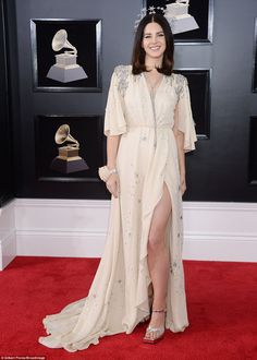 Singer songwriter Lana Del Rey wore her rose as a corsage, which matched beautifully with ...