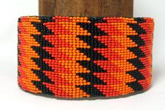 "What a jazzy bracelet! Made from glass seed beads sewn to a leather backing, Measures 2"" W x 8"" L and is adjustable. Fits most wrists. $16.95 w/ free shipping! #beaded #beadwork #bracelet #regalia"