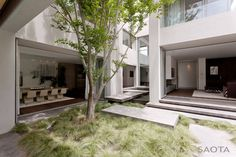 The facade is Georgian inspired but the modern aspect of the look is driven by a dynamic of recessed and projecting panels and cubes that create courtyards and terraces that articulate and add interest to what is a highly organized shell.