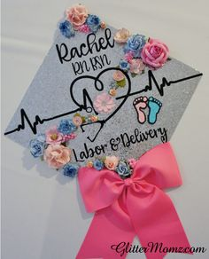 Nurse Graduation Cap Topper - Labor and Delivery - with flowers and bow Nursing Graduation Pictures, Nursing School Graduation, Graduation Diy, Decorate Cap For Graduation, Decorated Graduation Caps, Nursing Math, Nursing Goals, Nursing Pictures, Nursing Scrubs