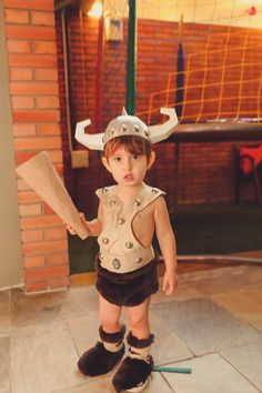My son Marcelo as Bobby The Barbarian from Dungeon & Dragons. Helmet and club made of paper. I made it for Carnival costumes contest and he WON!!