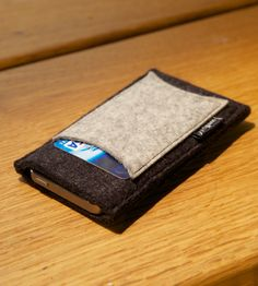 Grey Wool Felt Wallet & iPhone Sleeve, by Wellput (2/3) - 100% merino wool felt iPhone sleeve––with no zippers or bulky closures and there's a handy pocket for your bills and cards. Just slide in the ole phone and you're good to go.