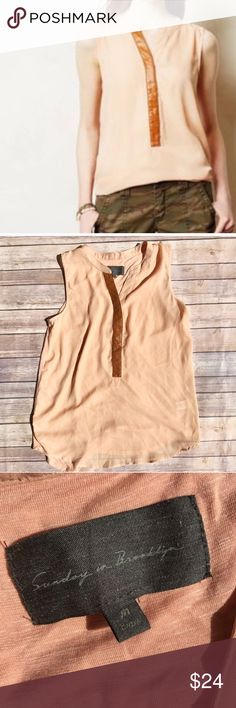 "ANTHRO Sunday in Brooklyn top size medium Excellent used condition without flaws. Anthropologie Sunday in Brooklyn peach colored tank with faux leather contrast to neckline. Size medium.                  ▪️shoulder to shoulder 14"" ▪️armpit to armpit 19"" ▪️length 27"" 🌵please check all measurements against your own clothing for best fit - all measurements are taken with garmet lying flat🌵 🖤please read all closet info prior to purchase Anthropologie Tops"