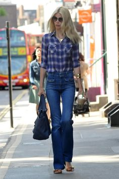 Claudia Schiffer: Stella McCartney pants, Chanel Embroidered Discs Bag, Mulberry Bayswater Sandals, Chloe Mimosa Round Sunglasses, Monica Vinader Ava Cuff & Monica Vinader Ava Pendant