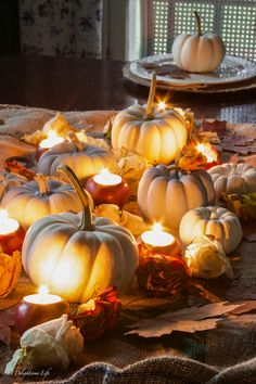 Romantic Fall tablescape with pumpkins, apple votives and dried roses on A Delightsome Life