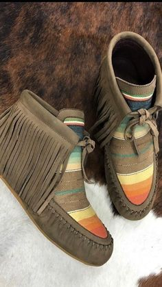 efbb3c621963e Leather stitched throughout the quarter of the Moccasins. Traditional  serape colorway for the toe box