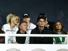 Pamela Anderson and Eva Mendes watch on as the Rabbitohs take on the Roosters at the Sydney Football Stadium.