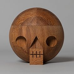 Kranium, Acne JR - Wooden skull with secret compartment. For keeping memories. Packed in a cardboard box with a graphic Kranium print. Size: Ø 14 cm. Material: Upcycled oak wood. Organic linseed oil. Kranium is also available in pine wood, white and black. Made in Sweden.
