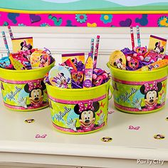 Minnie Mouse favor containers filled with favors for getting as dolled up as Minnie always is. Click for lots more Minnie Mouse party ideas!