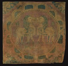 A fine silk textile fragment, Sogdiana, Central Asia, 8th Century composed of silk, woven with red, green, honey and blue threads, featuring a petalled roundel enclosing confronting lions standing above two calfs, the edges with sections of geometric designs, mounted against a silk background on card mount: 61 by 56cm. Sotheby's