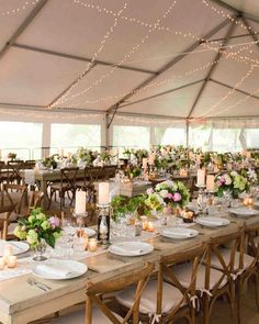 A Country-Chic Wedding on a New Jersey Farm | Martha Stewart Weddings - A tent was set up over the courtyard and decorated with fairy lights, creating a dream-like feel. In keeping with the color palette and the country-chic theme, there were a mix of round tables with pale pink tablecloths and farm tables with lace runners, finished off with cross-backed wooden chairs with pale pink cushions.