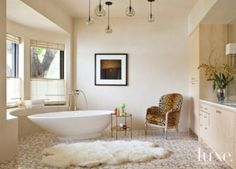 A sheepskin rug from Wildflower Organics finishes the space in this masterbathroom | See MORE at www.luxesource.com
