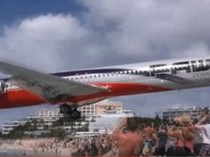Plane flies yards above tourists' heads in video shot at Caribbean island Saint Martin's Maho Beach | Americas | News | The Independent